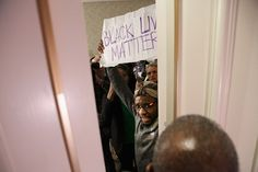 A Black Lives Matter protester is kept out of the main ballroom during a meeting of the U.S. Conference of Mayors at the Capitol Hilton on Jan. 20. Earlier that month, the city of Flint, Mich., declared a state of emergency because of ongoing lead pollution problems in the city's water supply.  GETTY IMAGES
