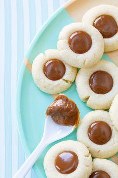 Dulce de Leche Shortbread Thumbprint Cookies - Bite sized buttery thumbrint cookies filled with creamy dulce de leche.