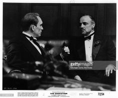 Robert Duvall having a conversation with Marlon Brando in a scene from the film 'The Godfather', 1972.