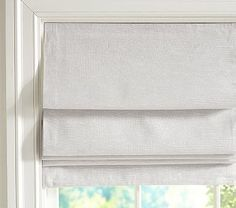 """Evelyn Linen Blackout Cordless Roman Shade #pbkids They only have Khaki and Gray.   We'd go with gray. This style is a more expensive option but might do better with the up and down we'll want in that room and the blackout of light we'll want at nap time. Check reviews. 26 X 64""""   32 X 64""""   36 X 64""""   44 X 64""""   48 X 64"""" $199 – $289 64"""" long; available in five widths cotton/linen blend. cordless design for style and added safety. White polyester/cotton blackout lining. Machine wash."""