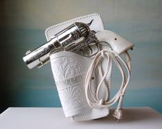 A BLOW DRYER WITH A BANG!!The 357 Magnum Gun Hair Dryer.