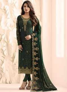 Dark Green Overall With Traditional Embroidered Detail And Digital Hints Churidar Suit will mesmerise rest of the crowd with your ethnic glow by wearing this set with shaded top embellished with zari and thread traditional embroidery work on georgette Eid Dresses, Pakistani Dresses, Indian Dresses, Indian Clothes, Pantalon Cigarette, Designer Party Wear Dresses, Churidar Suits, Salwar Kameez Online, Anarkali Dress