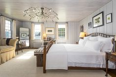 The master bedroom of Andy Warhol's former Hamptons mansion features a unique light fixture.