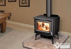 Enviro is proud to present their newest generation of wood stoves.  The Enviro 1200 wood stove is EPA approved, robust, and offers clean efficient heat. With up to 67,000 BTUs at 72% efficiency, you will enjoy looking through the large viewing glass, kept clean by the ultra strong air wash.  Choose from the step top or the flat top body style, gold and nickel options, and pedestal or legs.