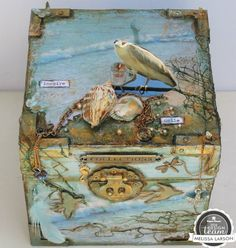 Beautiful sea inspired home decor piece created with scrapbook paper and embellishments.