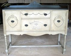 Mom's old buffet refurbished.  Annie Sloan French Linen body, Graphite top dark wax, Graphics Fairy topography