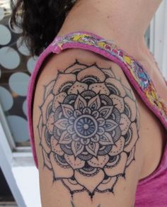 Blackwork mandala shoulder tattoo.
