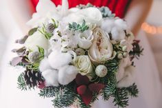 Christmas bridal bouquet. A beautiful bouquet of white flowers, cotton, and fir branches