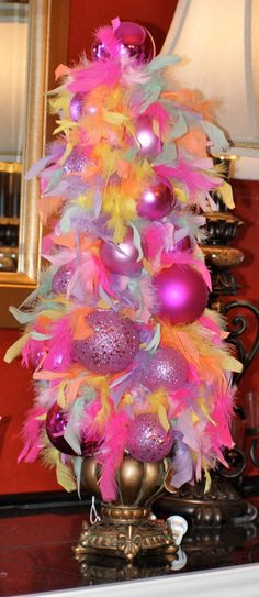 Feather boa tree topiary. Easily customized for different holidays using different color boas/bulbs.