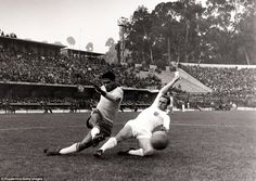 Garrincha crosses the ball past England defender Ray Wilson during the 1962 World Cup quarter-final in Chile. Garrincha scored twice in Brazil's 3-1 win in Vina del Mar.
