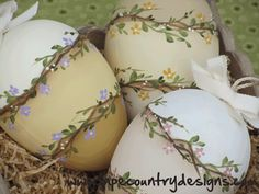 Like this...can keep them out all spring and summer...use wooden eggs.