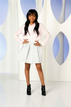 China tucks her shirt into her skirt and finishes of the look with black ankle boots. I love this look!