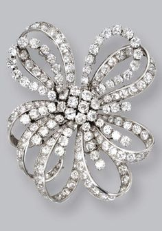 PLATINUM AND DIAMOND DOUBLE-CLIP BROOCH, MONTURE BOUCHERON, FRANCE, CIRCA 1935 Designed as a bow set with old European-cut and single-cut diamonds weighing approximately 26.80 carats, signed Boucheron Monture, maker's marks, French assay marks.