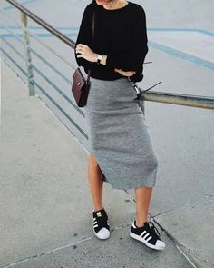 Grey midi pencil skirt and black blouse with sneakers for a casual pencil skirt look!
