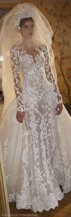 Love the Dress...can do without the crown and go with a simple veil as the dress speaks volumes.