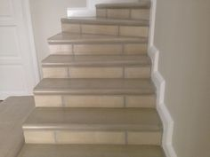 Smooth silica bullnose tiles as a step edging
