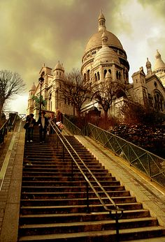 Architecture Research - Basilique du Sacré-Cœur, Montmartre, Paris. I like the low angle used to look up the stairs and then at the Sacré-Cœur and this makes it look far away and this makes it appear superior.
