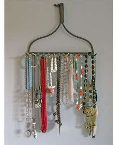 Rake-ish  An old rake gets new life as a streamlined jewelry organizer—with room for all your necklaces, bracelets, and a scarf or two if you like. Wash and scrub the rake before putting it to use, then simply hang it from a nail on the wall. All your accessories are now