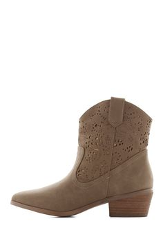 Ambling in Albuquerque Boot. Slip on these taupe cowboy-style boots by Restricted and head out to greet the warm Southwestern sun! #tan #modcloth
