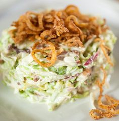 Ruth Chris Steakhouse Copycat Recipes: Chopped Salad --  Lemon Basil Dressing: 2 cups sour cream  1/4 cup chopped fresh basil 4 -5 tablespoons fresh lemon juice seasoned salt and garlic pepper seasoning