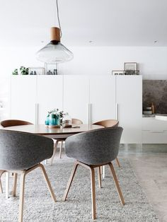 modern dining room design / white cabinets for the kitchen / great ceiling light / killer chairs