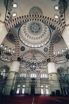 Ṣehzade Mehmet Mosque [Great Firmament arch with four pillars with triple aches. Notice the sacred black and white alternating pattern of the arches and the window gates of the sun.]