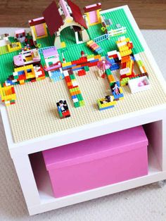 Stick Velcro strips to the back of Lego boards to make an awesome Lego table: