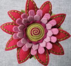 100% Fine wool Felt Flower Brooch. Raspberry, Rose and lilac petals with Celery and Pea center. 2 1/2