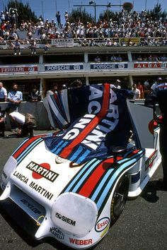 The Martini Racing Lancia LC2-84 0005 of fastest qualifiers Bob Wollek and Alessandro Nannini is parked on the front straight before the start of the 24 Hours of Le Mans FIA World Sports Car Championship race at the Circuit de la Sarthe in Le Mans, France, on June 17, 1984.