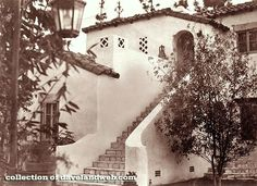 """I just discovered this photo of the Garden of Allah on Dave DeCaro's always-interesting Davelandblog site. I don't know which villa this was, but it gives us a wonderful idea of what life at the Garden of Allah was like. I love the little touches, like the way the banisters at the bottom of the steps curve out outward; that decorative square-within-a-square near the roof; and that urn at the top of the stairs could have been lifted from the set of the 1936 Dietrich movie, """"The Garden of…"""