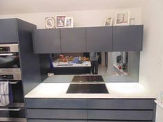 Black Toughened Mirrored Kitchen SPlashback