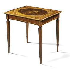 An Italian fruitwood inlaid kingwood, tulipwood and mahogany games table attributed to Giuseppe Maggiolini, Lombard  circa 1800 with a rectangular top inlaid with a roundel enclosing a floral spray within a scrolling foliate border, on square tapering legs