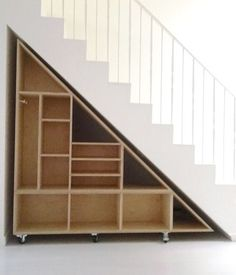 Idea for under stairway in the basement- will have to open from the narrow end for our basement...