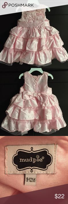 Frilly pink dress by mud pie Baby pink, frilly dress by mud pie. Size 9 to 12 months. In great condition. Also comes with pink tights that have lace on the back (by Carter's). From a clean, smoke free home. Price is firm (unless using bundle discount) due to Posh fees. Mud Pie Dresses