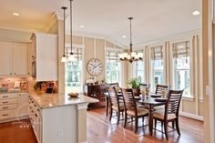 love the white cabinets with the light granite and the wood trim on the wall adds interest to a otherwise boring paint color