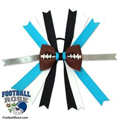 Handmade Football Hair Bow made from real football leather with Carolina Blue, Black, Silver, and White ribbon accents inspired by Carolina football Football Hair Bows, Football Team, Carolina Football, Different Font Styles, Team Mom, Elastic Hair Ties, Making Hair Bows, White Ribbon, Carolina Blue