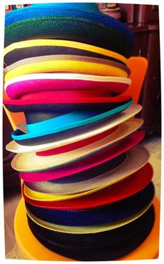 Hat tower!  We are in love with our newest hats in a colorful variety!  PRYMAL 100% handmade Panama Hats