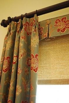 Love the little valance on top of the woven bamboo. It adds great layering to this treatment. by Brigitte Rachal LaBorde