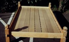 Collapsible slat bed. Camp in style, then fold it up and take it home with you.