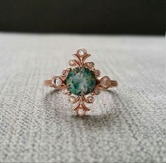 Teal Moissanite Victorian Ring - love this stone!