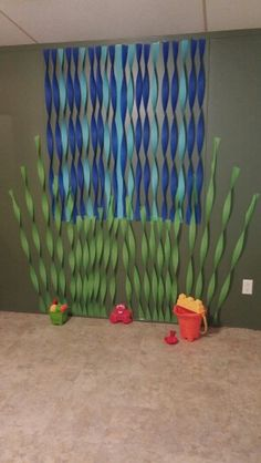 We did a finding nemo theme for my sons first birthday party. I decorated our wall too give it an ocean effect.