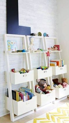 Beautiful toy organisation idea using these stacked, tiered ladders for sorting books, toys and memorabilia