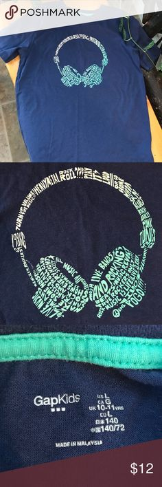 Gap Kids Headphones And Music Tshirt EUC. My son wore this a few times before he outgrew it. He looked so cute in it  Navy blue tshirt by Gap Kids with music-inspired text in the shape of headphones. No flaws, design is in perfect condition with no peeling or cracking. Boys size large (10-11 years). Add kids clothes to a bundle for a great discount! All of my pre-loved items have been freshly laundered and come from a clean, smoke free home. GAP Kids Shirts & Tops Tees - Short Sleeve