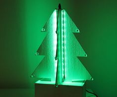 This stunning Christmas tree lights up automatically when the environment light goes low under a defined value. It is based on an Arduino Pro Mini board and a RGB LED strip. It uses a BH1750FVY sensor for measuring the light. A push button allows to set different LED colours and effects or to turn it ON when the light is not low.Bill of materials: paper, pencil, ruler, balsa wood boards and beams, cutter, sandpaper, rapid glue, hot glue (optional), soldering iron, paint brush, acrylic…