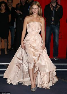 Berlinale princess! Lily James attended the world premiere of Cinderella on Friday night wearing a Dior strapless ball gown, without a corset, and her very own 'glass slippers' by Jimmy Choo