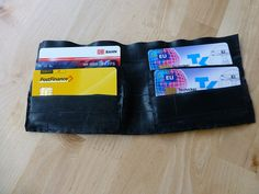 Recycled bike tire tube wallet by docnessie