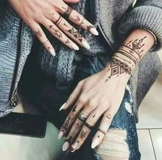 Love henna tattoos on the hand