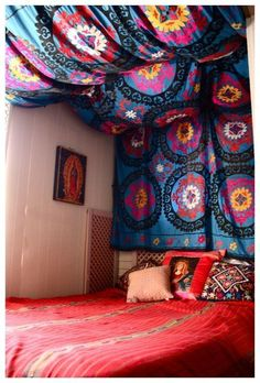 DIY tapestry headboard. This would be a cool way to dress up your college dorm room very easily. This also gives me the idea to cover the walls with fabric (budget in mind) if ther are cinder blocks to make it feel cozier
