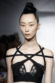 The Chromat 3D Printed Odile Bustier: neoprene body with 3D printed cups, black elastic strap details and back zip. Cup printed in Black Acrylonitrile Butadiene Styrene (ABS) non-flexible material. Re