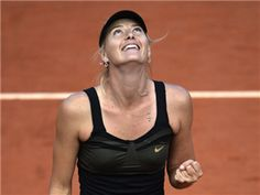 Russia's Maria Sharapova reacts after winning over Czech Republic's Petra Kvitova during their Women's Singles semifinal tennis match of the French Open tennis tournament at the Roland Garros stadium, on June 7, 2012 in Paris.
